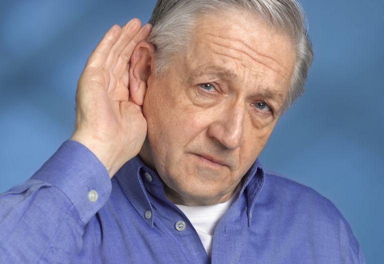 Man having touble hearing