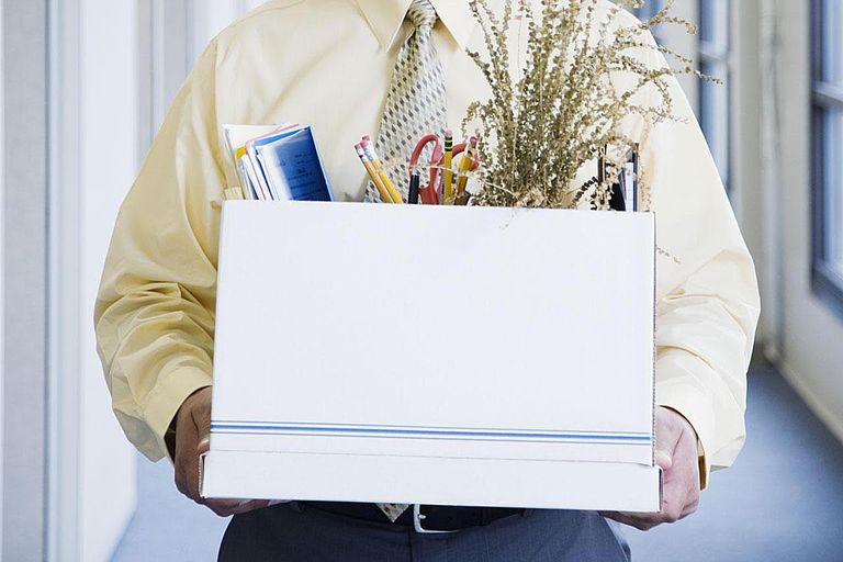 Office worker carrying box