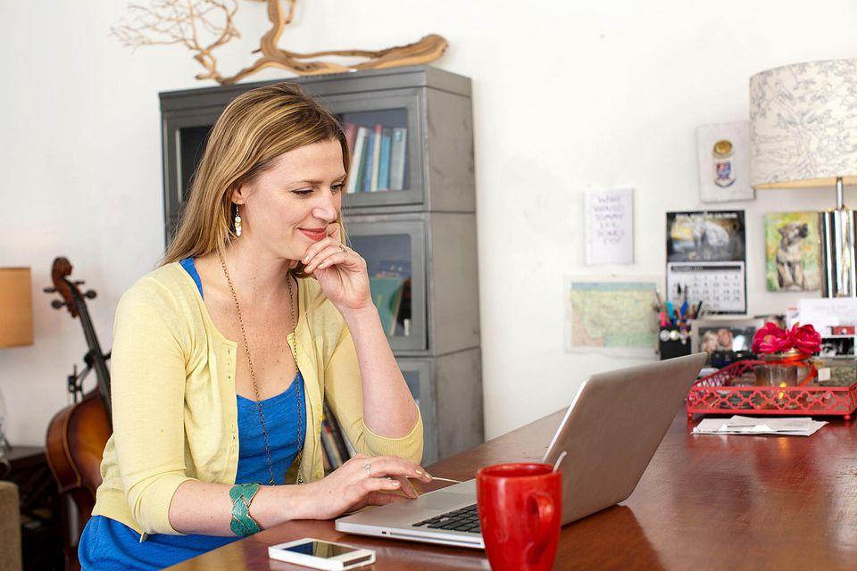 woman searching Craigslist on laptop