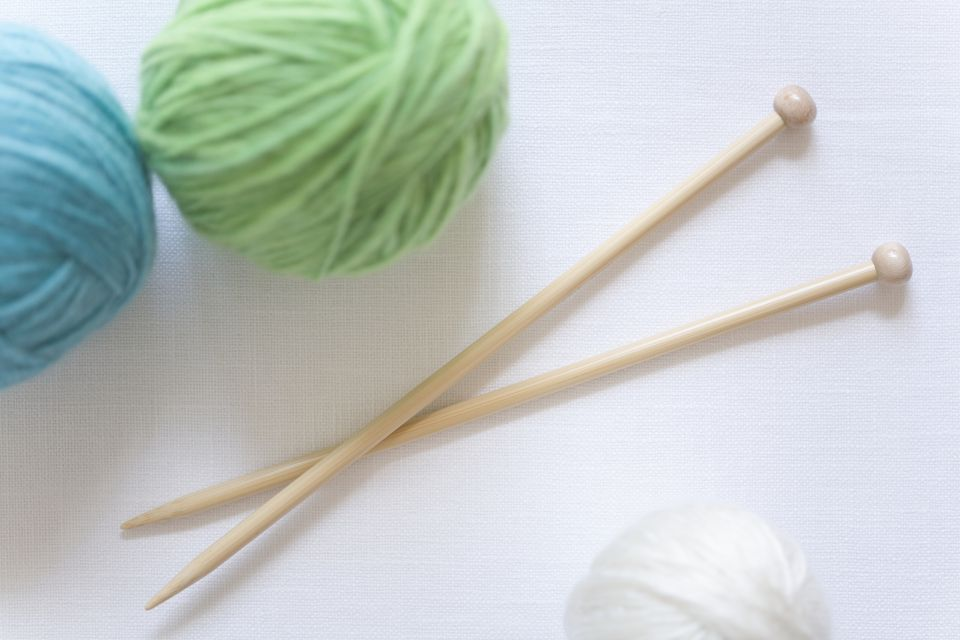 Knitting needles with balls of yarn, close-up