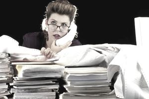 Busy Woman with work pile on her desk