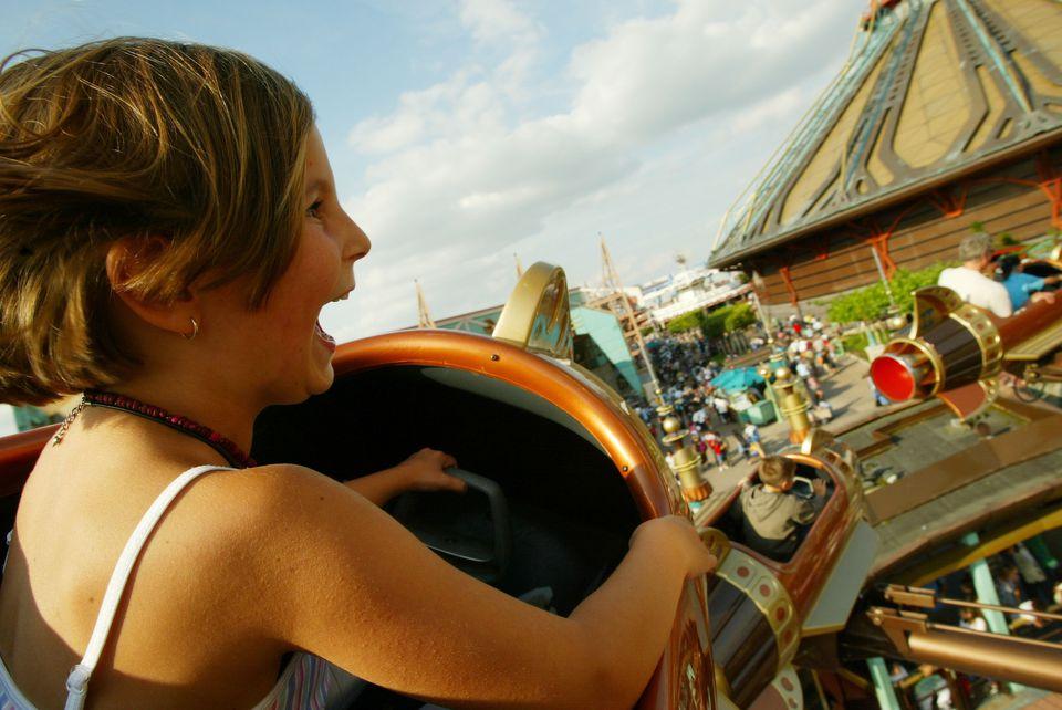 A child enjoys the rocket ride at Disneyland Paris.