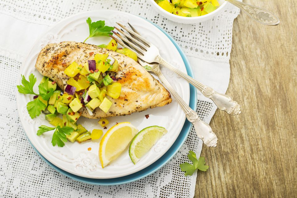 Grilled chicken breast with fresh salsa frompineapple and avocado red