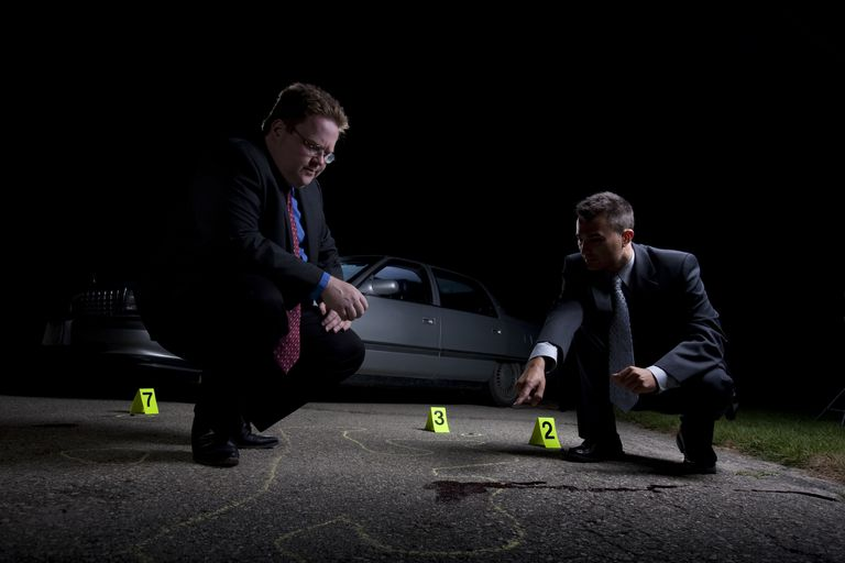 two detectives at crime scene