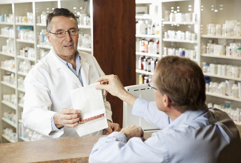 Pharmacist giving medicine to customer