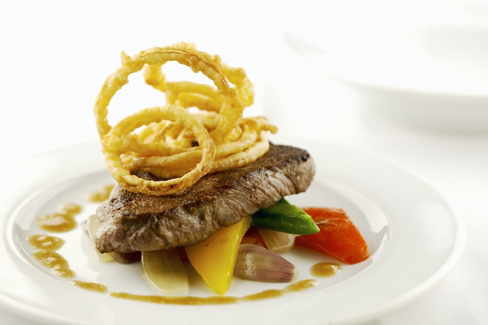 Steak Garnished With Onion Rings