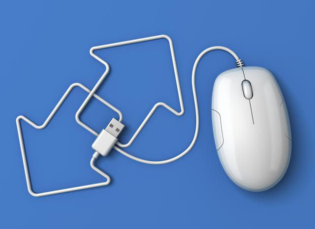 Computer mouse with blue arrows