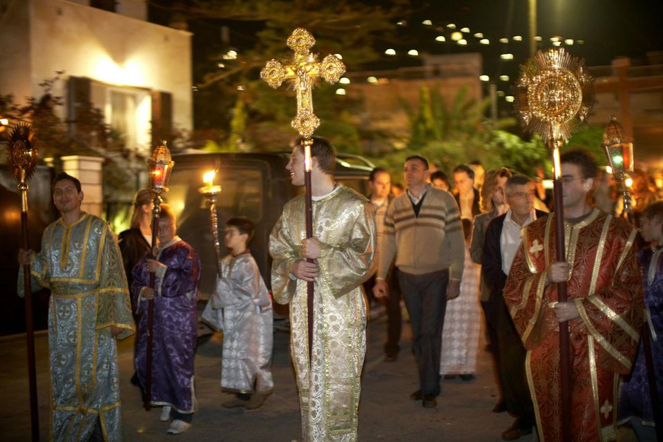 Night time Easter Good Friday procession of Epitaphio through streets by congregation of Orthodox Church in Saronida, Attica