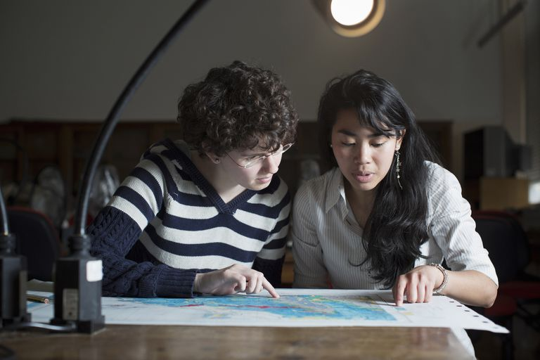 Students reading map in class