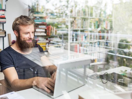Man in office on computer