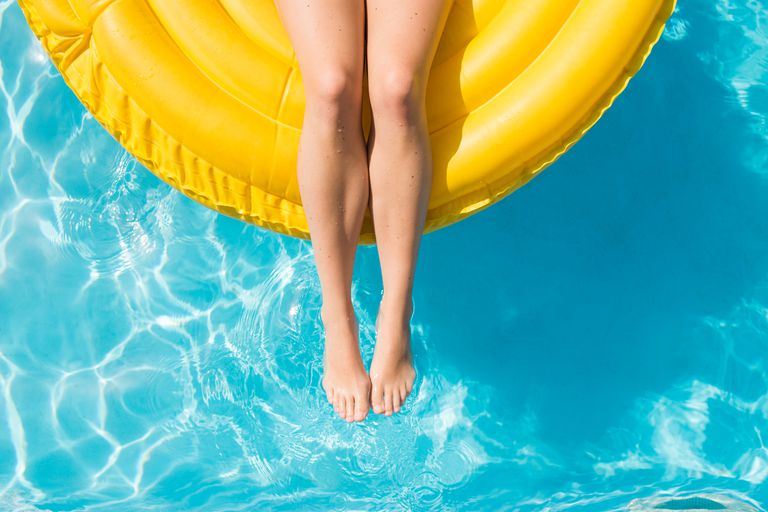 Woman floating on tube in the pool