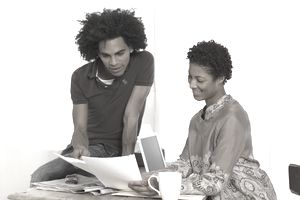 Young couple reading paper