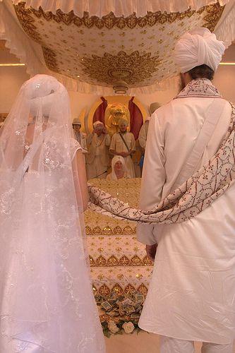 Bride And Groom Stand Before Guru Granth Sahib