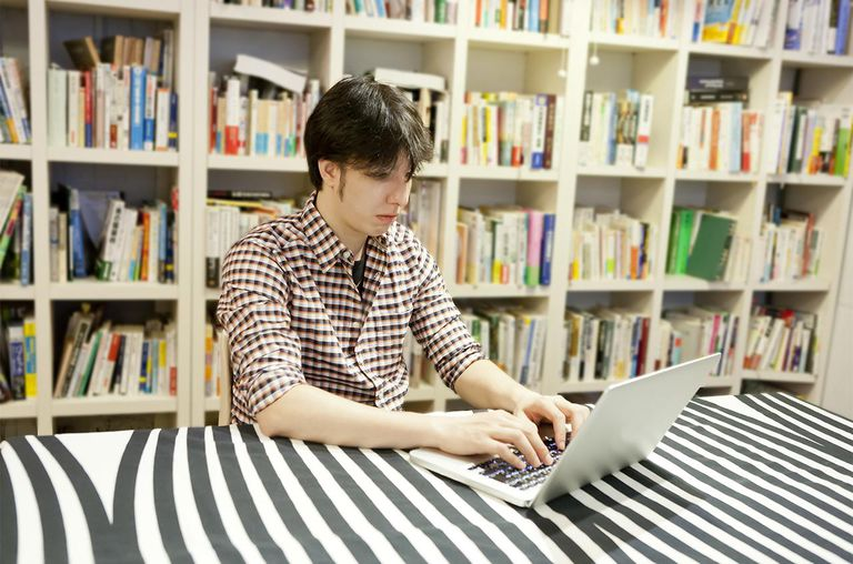 Young man using laptop in room