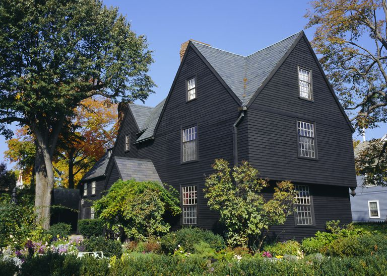 Dark-colored House of the Seven Gables, 1668, Salem, MA, made famous by Nathaniel Hawthorne