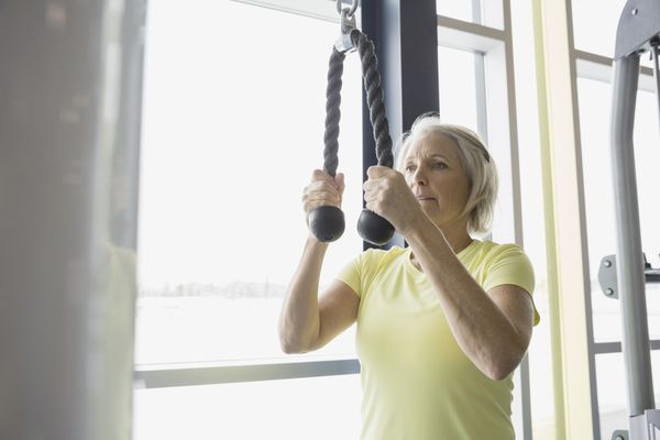 woman doing triceps exercise in gym