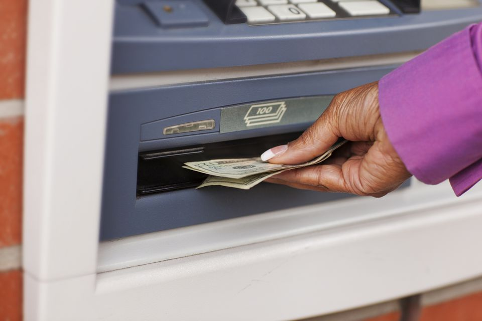 Black Woman Receiving Cash From ATM