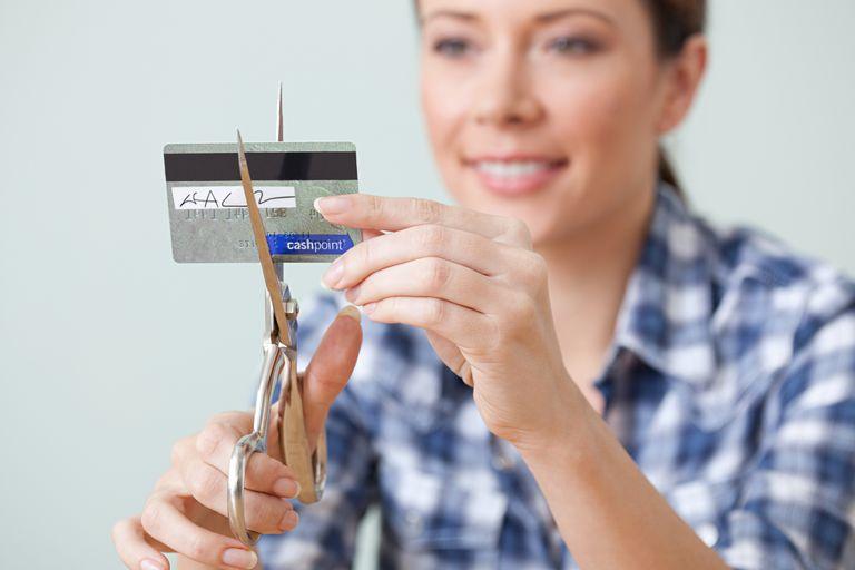 A woman cuts up a credit card