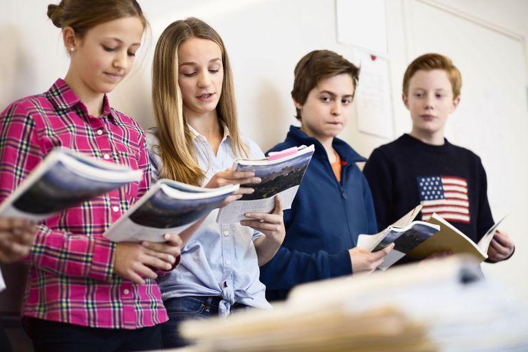 School friends studying in classroom