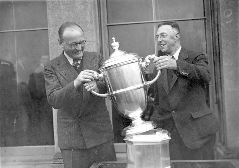 British captain John Beck (left) and American captain Francis Ouimet with the Walker Cup in 1938