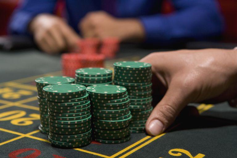 stacks of chips at gambling table