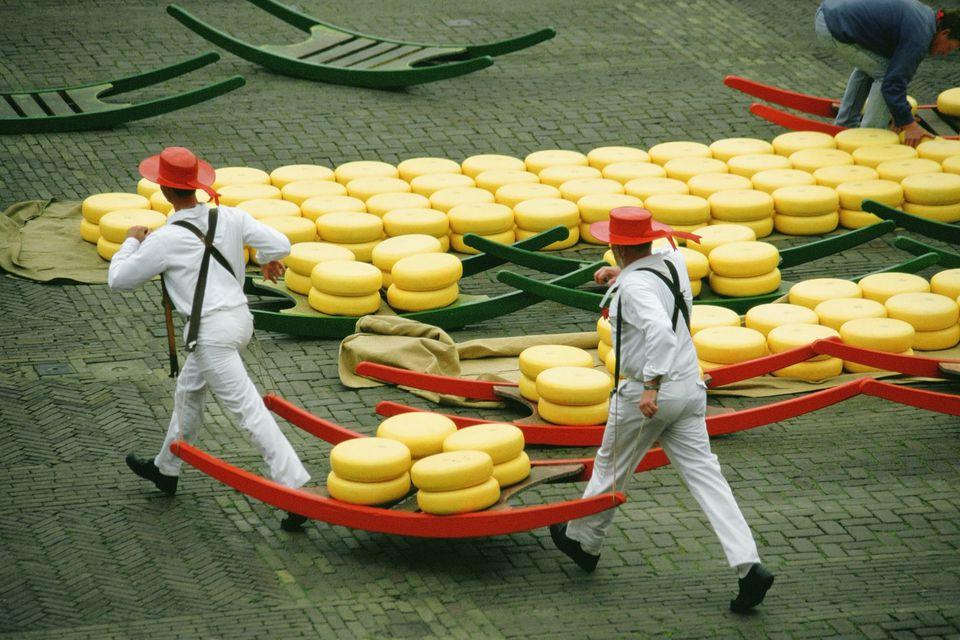 High angle view of two men carrying cheese, Alkmaar Cheese Market, Alkmaar, Netherlands