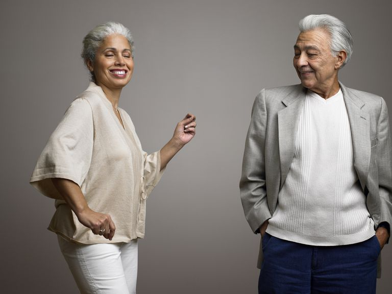 Man watching wife dance as she gets near retirement age.