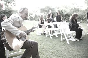 Man playing guitar at wedding ceremony