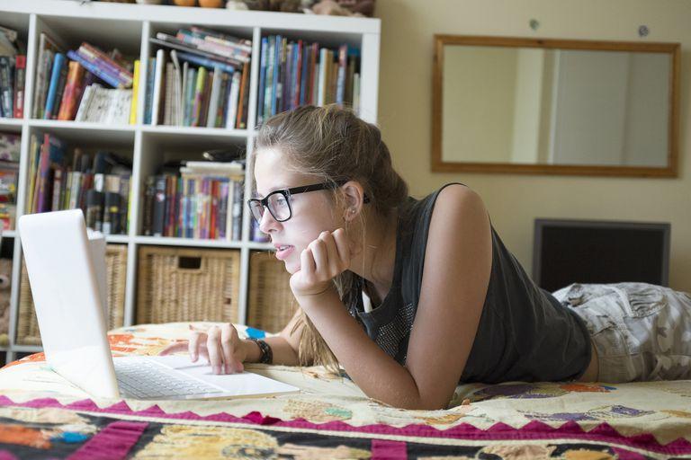 Teenage girl using laptop