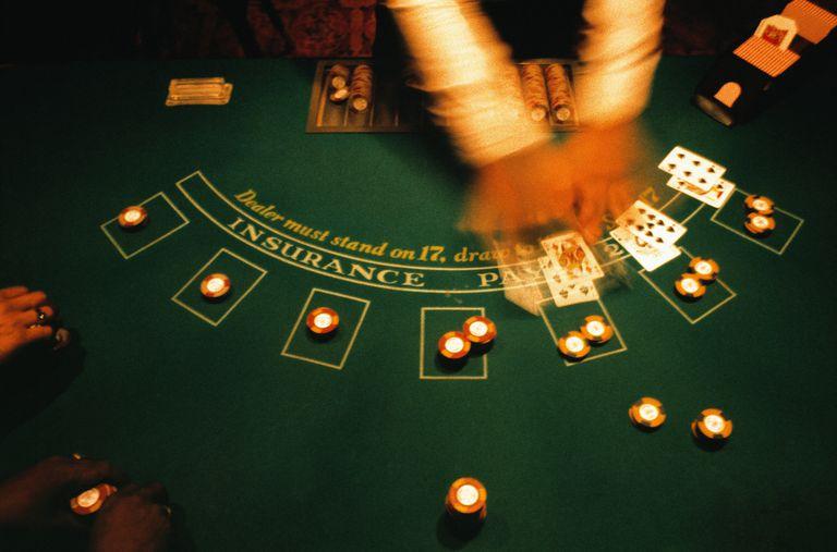 Casino dealer dealing blackjack