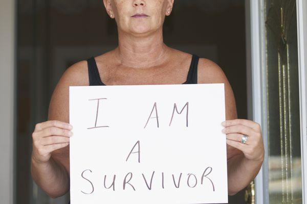 cancer survivor with sign