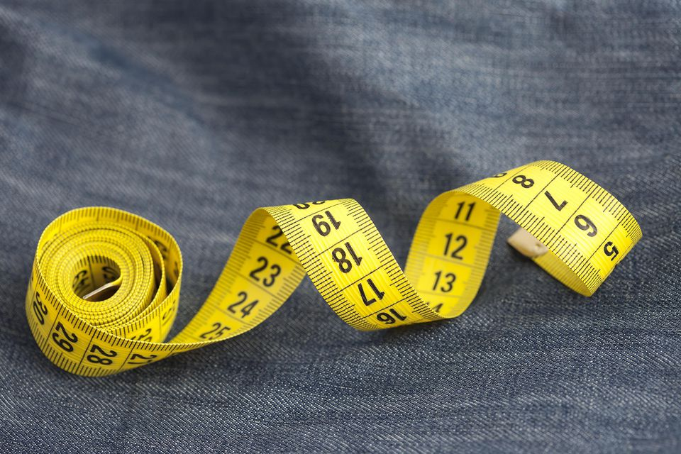 Measure tape on jeans