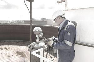 Man testing a fuel storage tank.