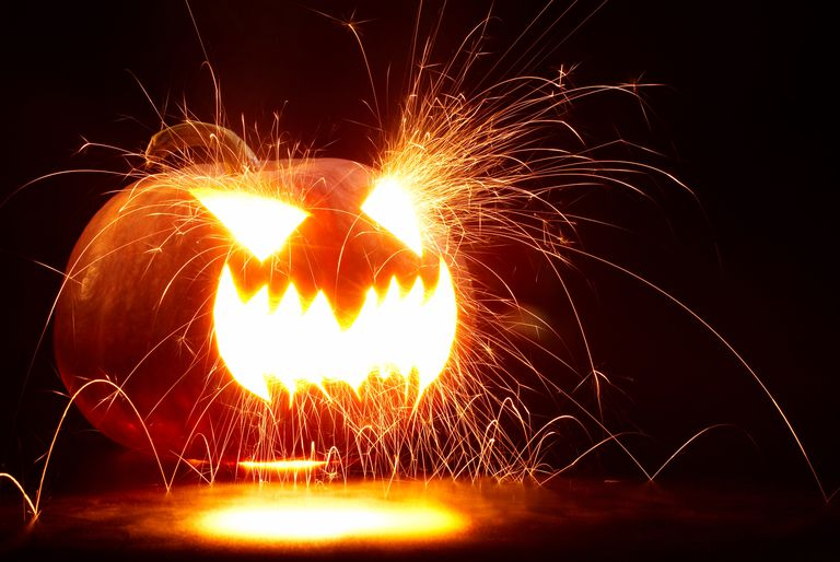Igniting acetylene gas produced by a chemical reaction blows the face out of a pumpkin. It's like the pumpkin carves itself!