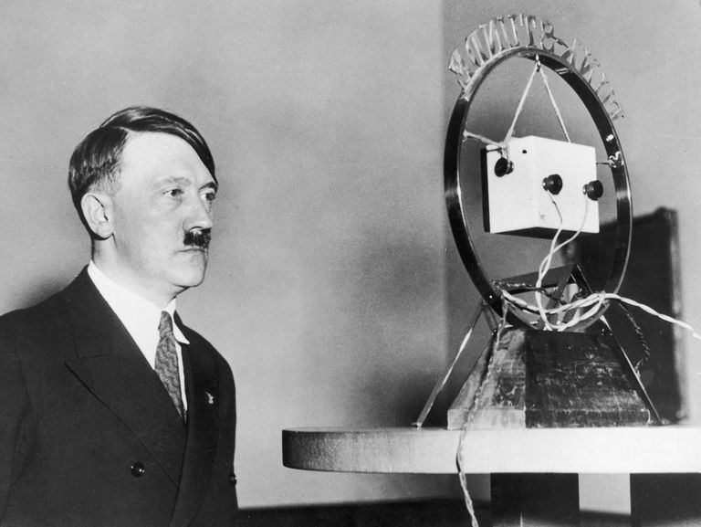 February 1933: Nazi leader Adolf Hitler (1889 - 1945) makes his first radio broadcast as German Chancellor in front of a radio microphone.