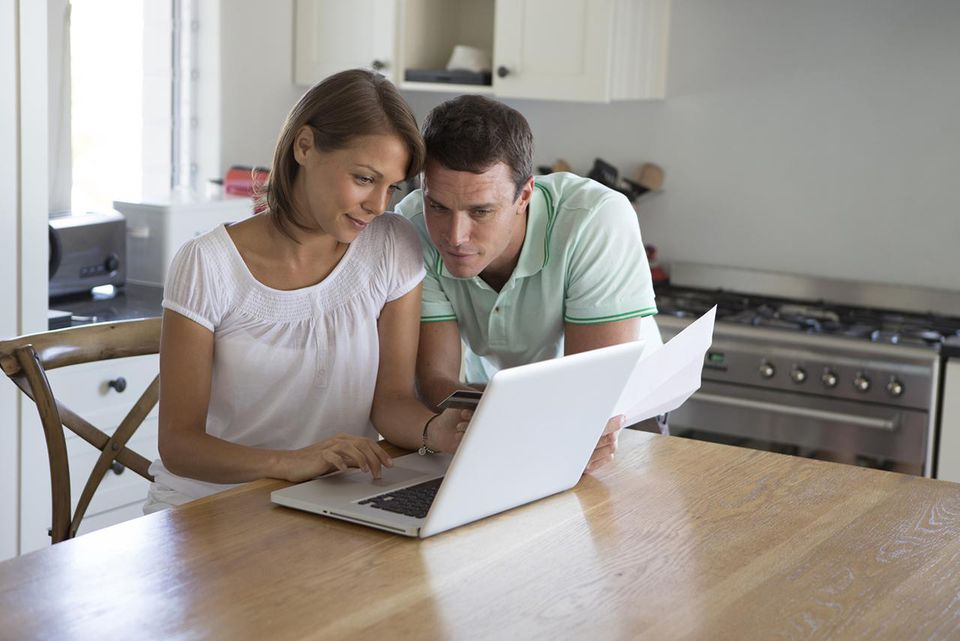 Couple using computer to shop at home