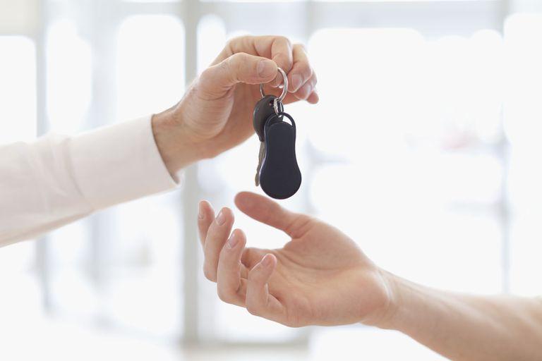 Car salesman handing keys to customer