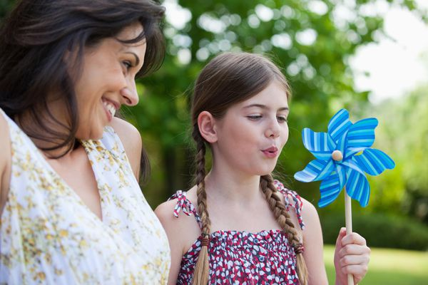 Mother and daughter with pinwheel