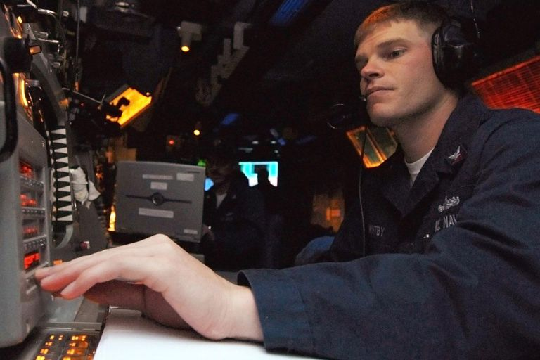 PACIFIC OCEAN - FEBRUARY 16: In this photo provided by the U.S. Navy, Fire Controlman 2nd Class John Whitby, from San Leandro, CA, operates the radar system control in the combat information center during a ballistic missile defense drill February 16, 2008 aboard the Ticonderoga-class guided-missile cruiser USS Lake Erie (CG 70).