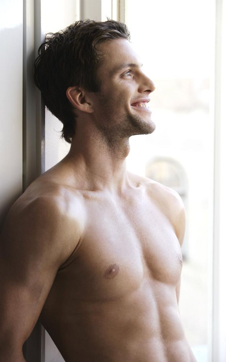 Young man smiling, bare torso