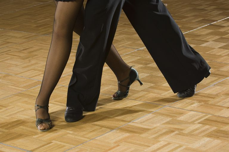 Close up of couple salsa dancing