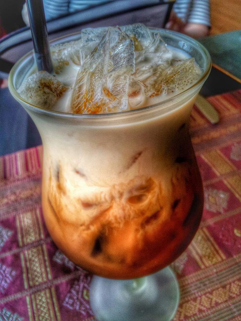 A glass of Thai iced tea.