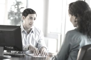 USA, New Jersey, Jersey City, Man and woman talking at desk during job interview