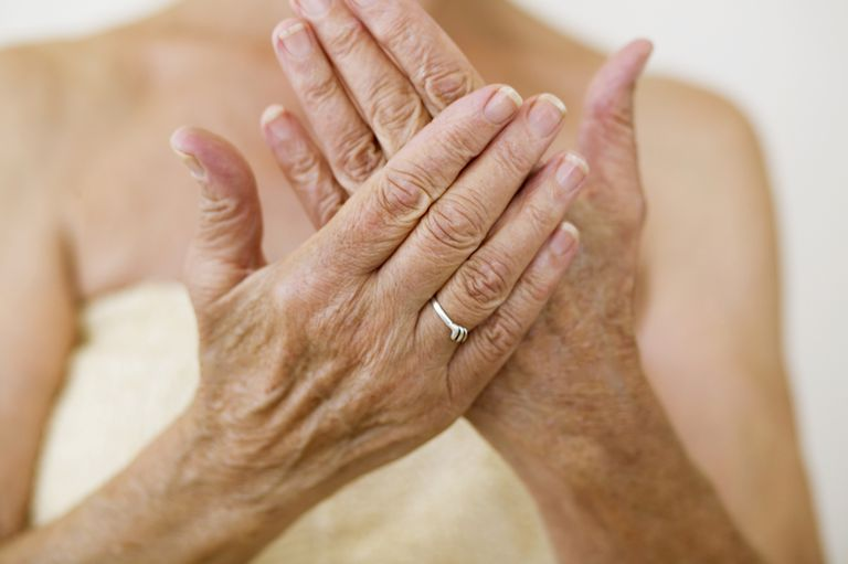 Woman Applying Lotion to Hands