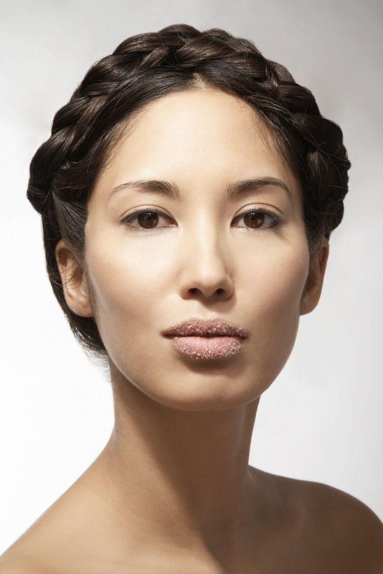 Woman with sugar lip scrub on her lips