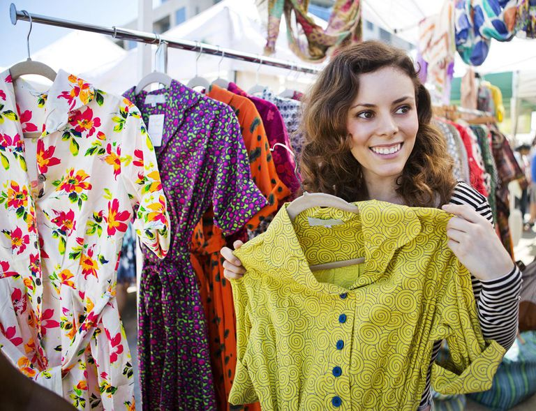 Young Woman with Colorful Dresses at Flea Market