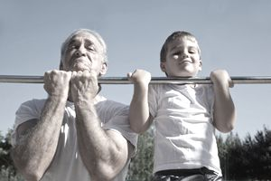 Grandfather and grandson doing pull ups