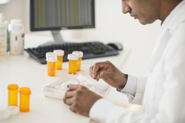 A pharmacist prepares a prescription.
