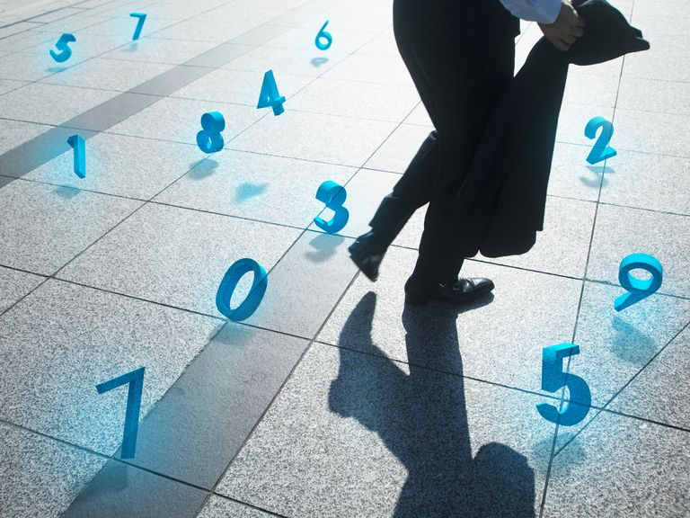 Businessman with financial numbers