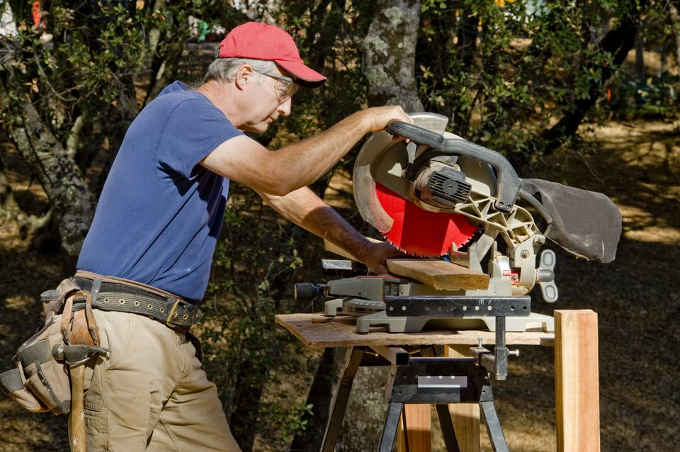 Man using Compound Miter Saw